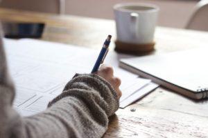 woman writing CV at desk