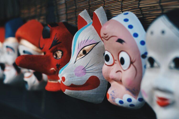 Halloween masks hanging on wall