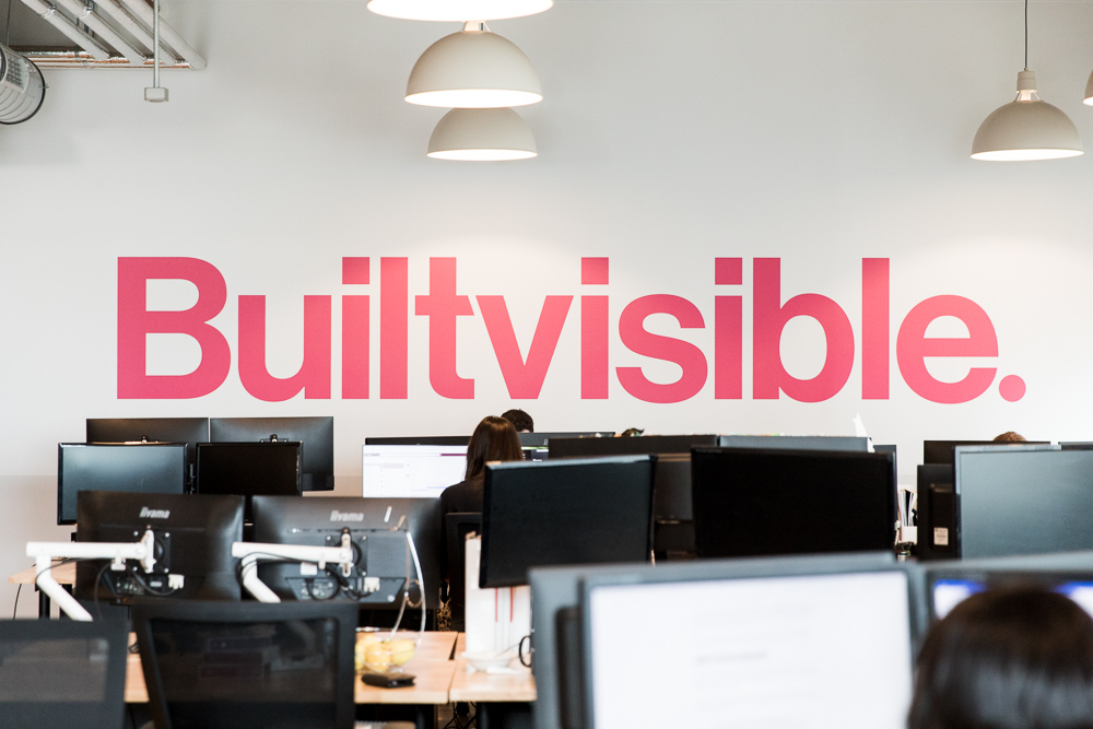photo of Builtvisible's office with their logo on the wall