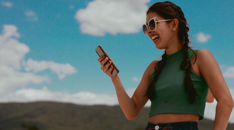 Girl looking at phone smiling